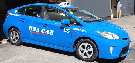 Car with USA Cab company color scheme- blue car with white lettering.