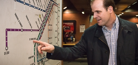 A passenger touches a tactile Muni system map