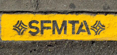 "Painted yellow curb with ""S,F,M,T,A"" letters painted in black."