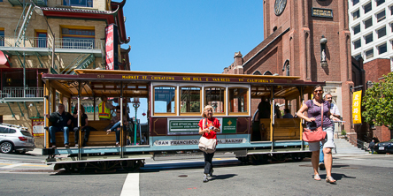 Passengers disembark a California Street Cable Car at Chinatown's Grant Street