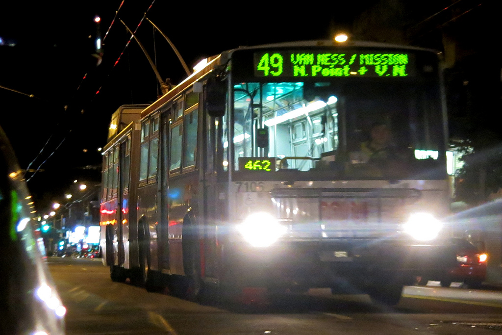 Front of 49 Van Ness/Mission trolley bus on the street at night