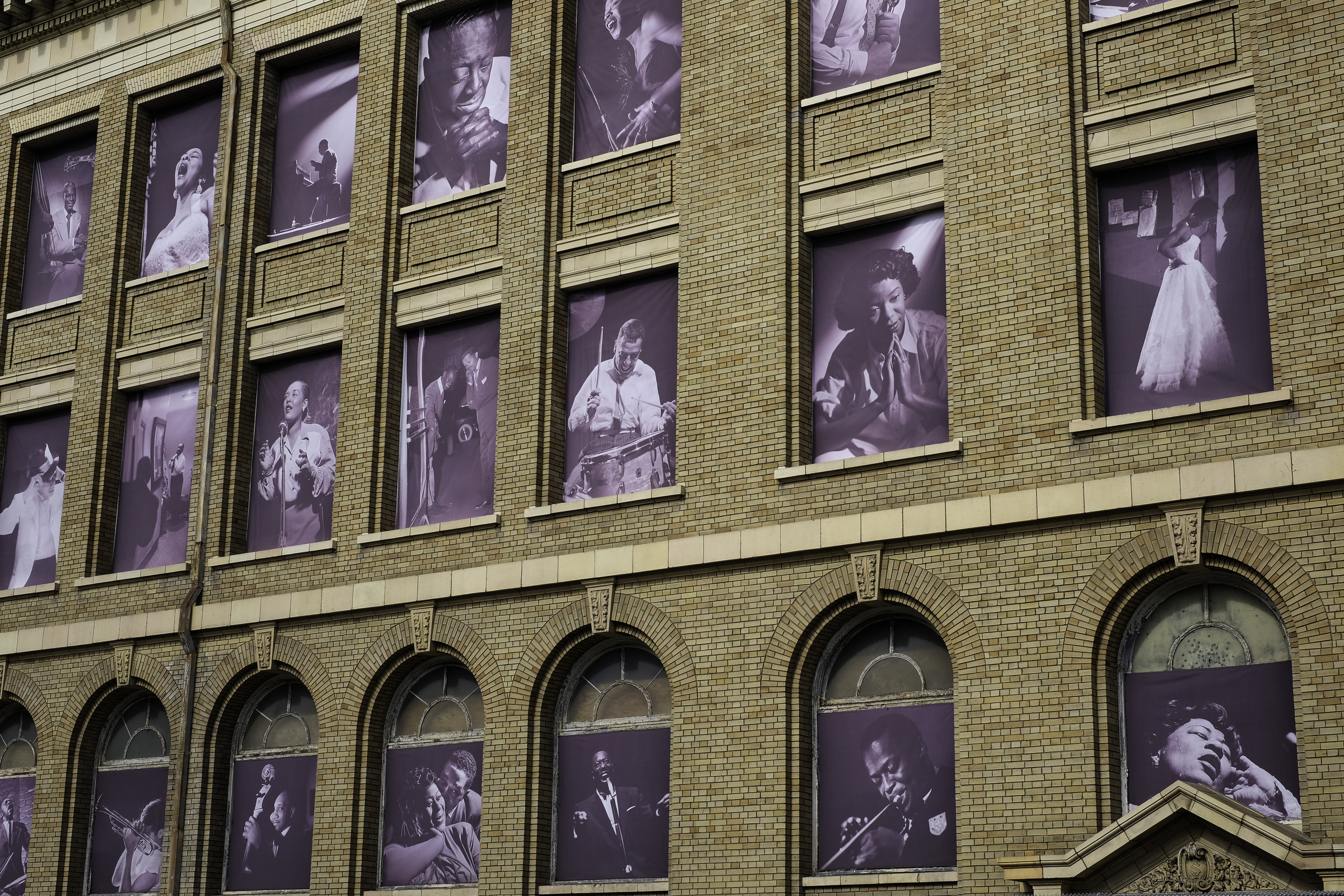 Photos of jazz icons in the windows of the former San Francisco Unified School District building across the street from the SFJAZZ Center