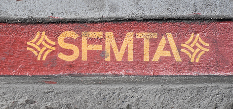 Red painted curb with SFMTA logo.