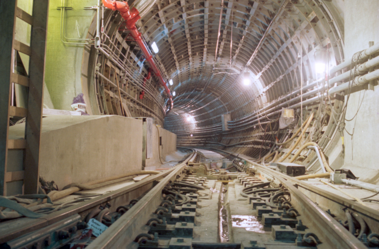 Photo showing a curve inside the Muni Metro Tunnel during construction. Taken September 4, 1996.