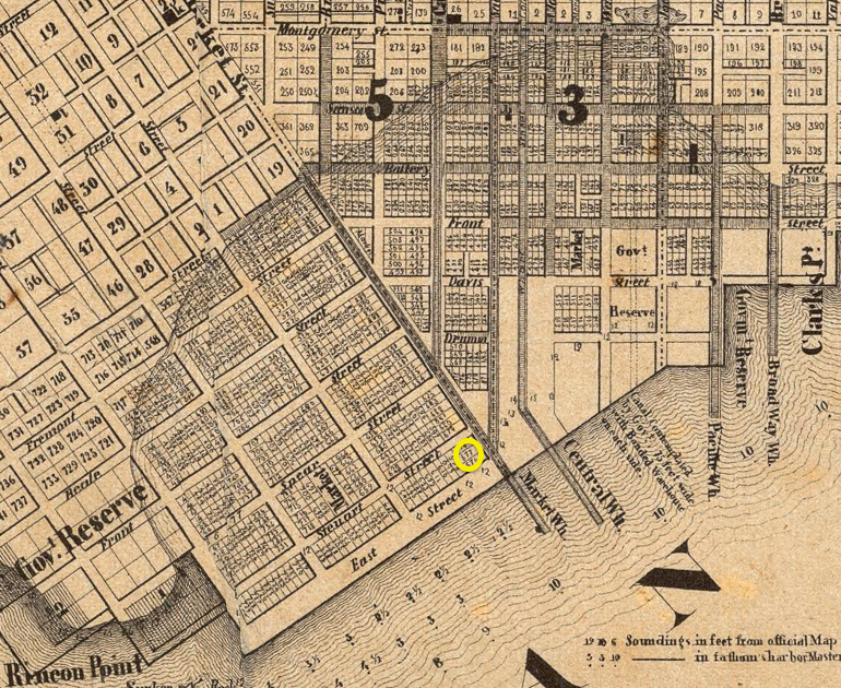 Detail of a historic 1852 map showing the street layout in downtown San Francisco, focused on the eastern end of Market Street, at present-day Market and The Embarcadero. The map includes a line indicating the original eastern coastline, roughly along Montgomery and 2nd streets.