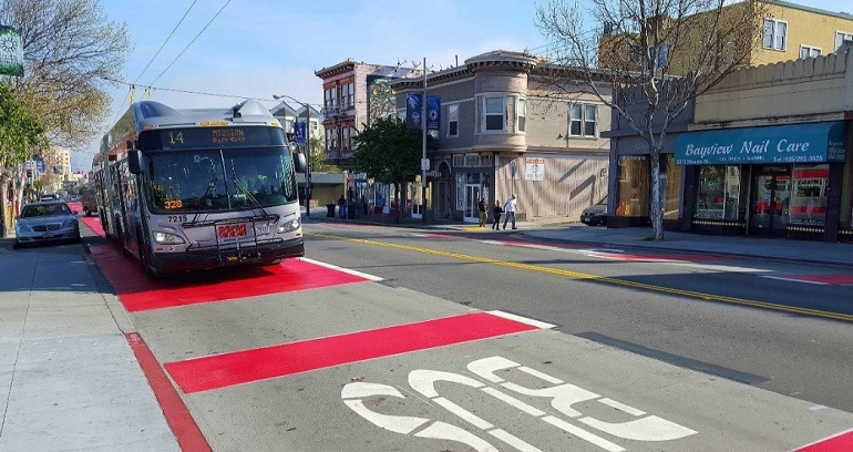 New 14 Mission trolley bus glides over the freshly installed red lane in the Excelsior.