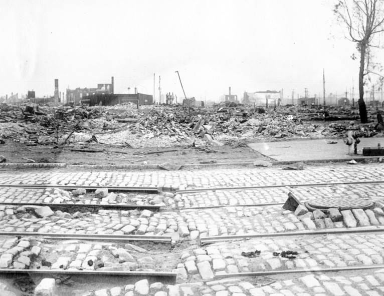 An image of 10th and Brannan streets on May 12th, 1906 shows damaged streetcar tracks and cobblestones, with a view of the decimated cityscape in the background.