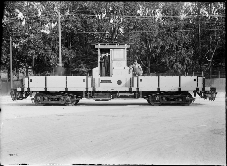 Side view of Muni work streetcar C-1, a flat car with a central control booth.  Taken March 17, 1916