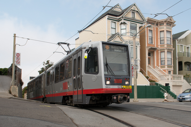 color photo showing a Muni LRV passing by two Victorian style houses on 21st and Chattanooga streets in the dolores heights neighborhood taken in 2014.