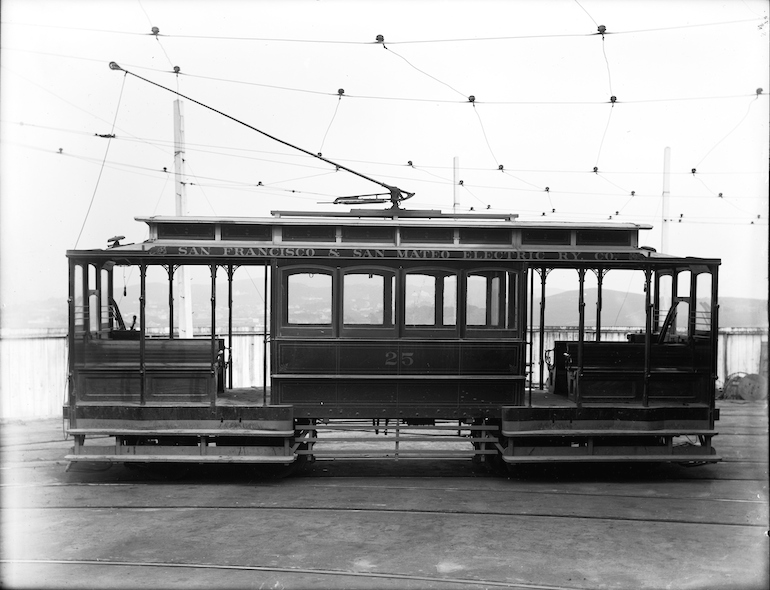 Black and white photo showing the side of an electric streetcar in 1903.