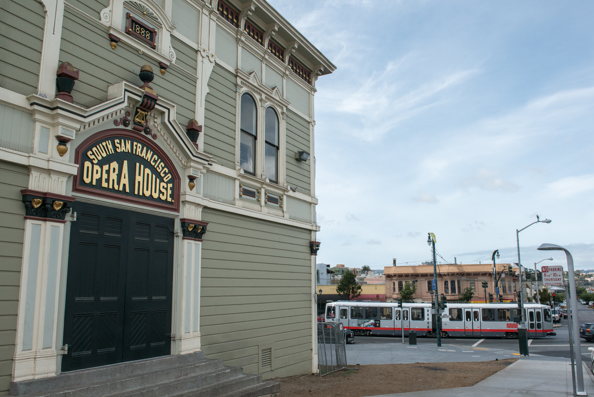 House hunters san francisco bay - Facade Of The Bayview Opera House With A Muni T Third Light Rail Vehicle Running In