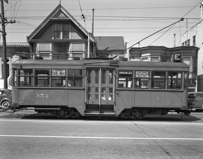 Side view of single-truck J Type Streetcar 352 From Union St. E Line on Masonic and Geary | May 4, 1942 | D4728C