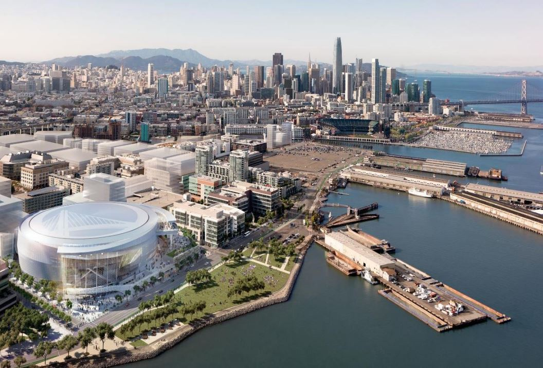 Rendering of the proposed Warriors arena with a photograph of the surrounding area and downtown San Francisco in the background.