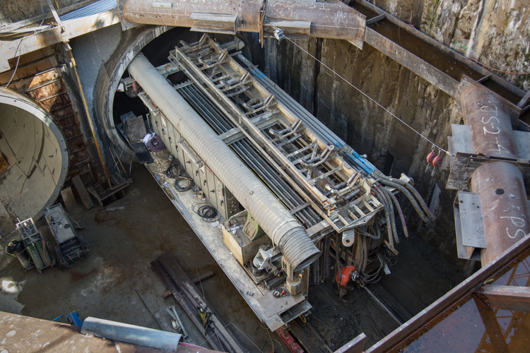 Tunneling machinery sits at the bottom of the 70-foot Central Subway retrieval shaft.