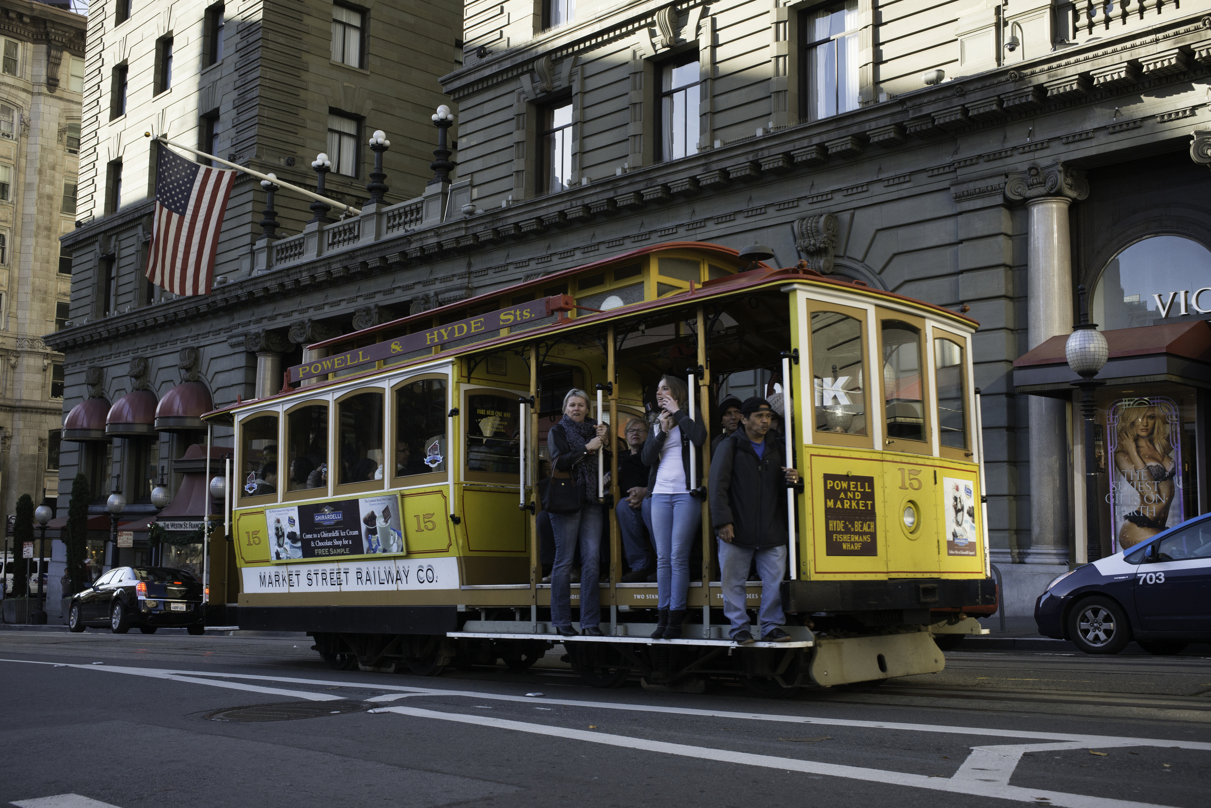 The yellow cable car 15 rumbles north past the Westin St. Francis Hotel on Powell Street.