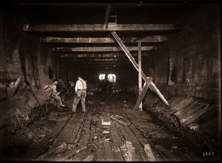 Workers Digging Rock and Dirt for Construction of Twin Peaks Tunnel near Eureka Station | Circa 1916