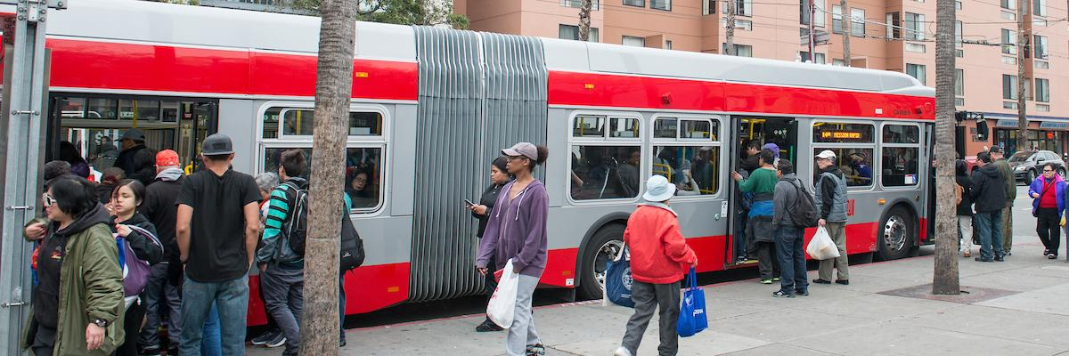 Photo of Muni bus and passengers in Mission