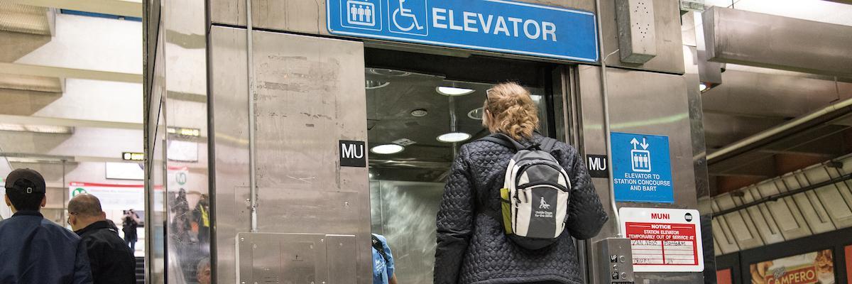 person walking into Muni elevator