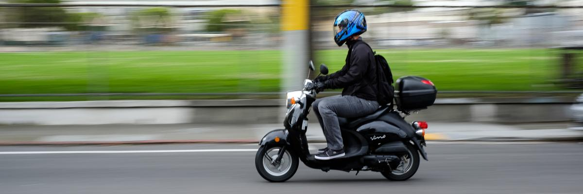 image of motor scooter rider with helmet