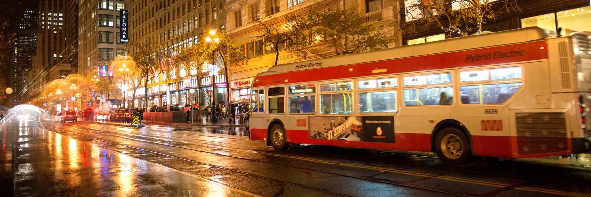Image of Muni bus at night on Market
