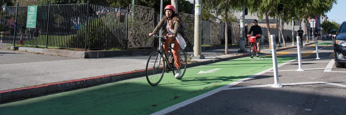 Woman in helmet biking along folsom