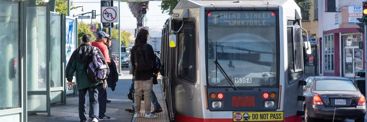 People boarding the T Third light rail vehicle