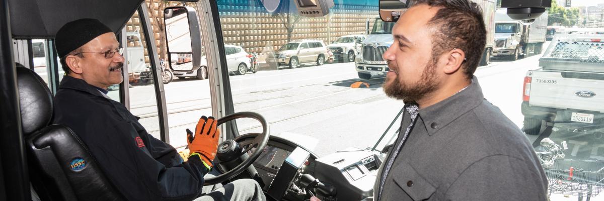 man boarding bus greets operator