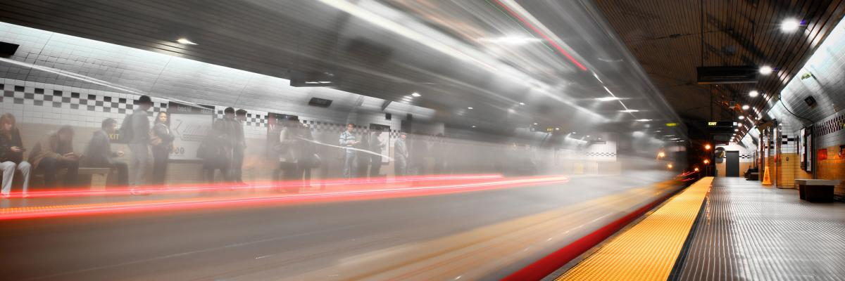 image of a train in motion in the subway