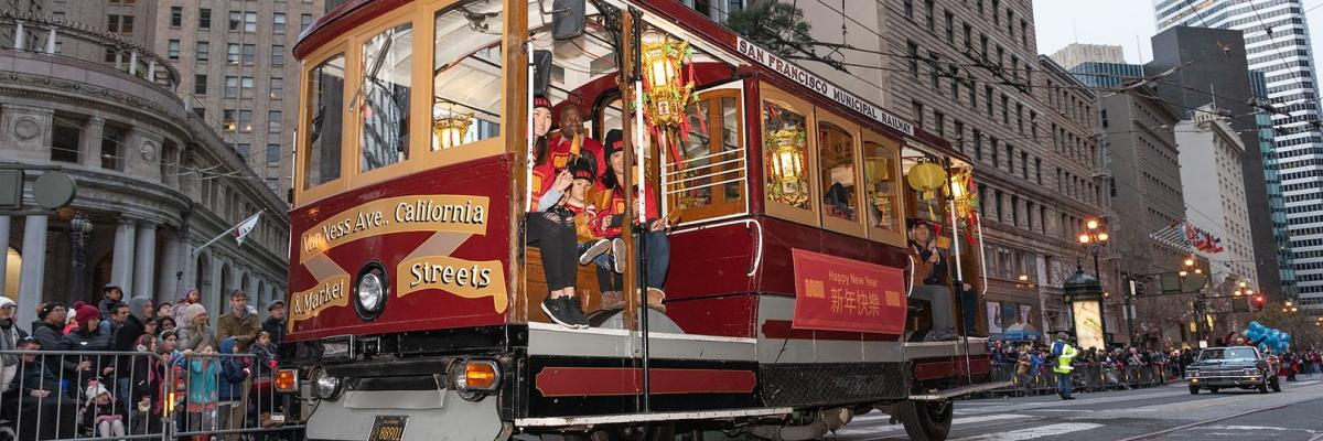 San Francisco rubber tire cable car participating in Chinese New Year Parade