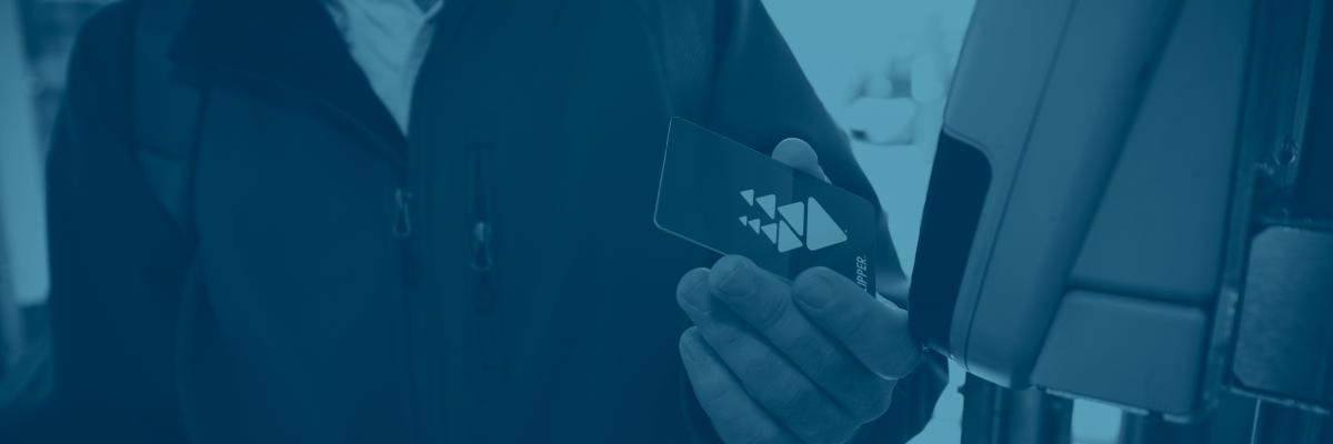 Customer holding a Clipper card
