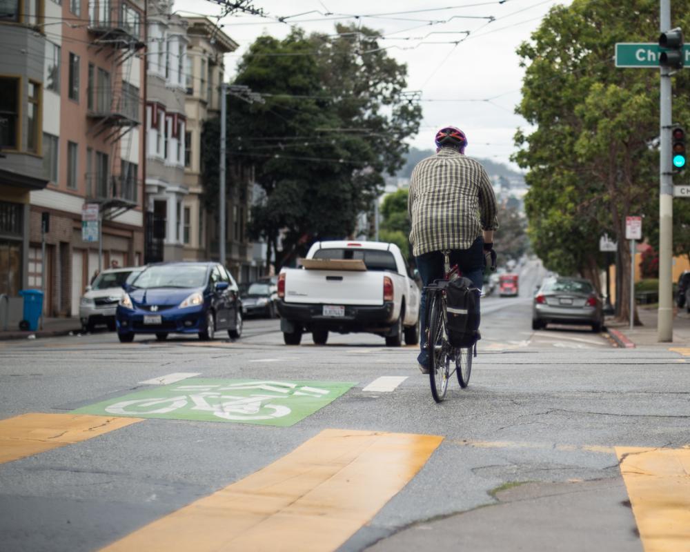 Man bicycling across Church street on 17th street