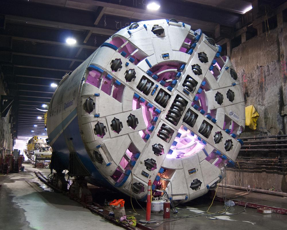 The forward portion of tunnel boring machine Mom Chung is seen being assembled.