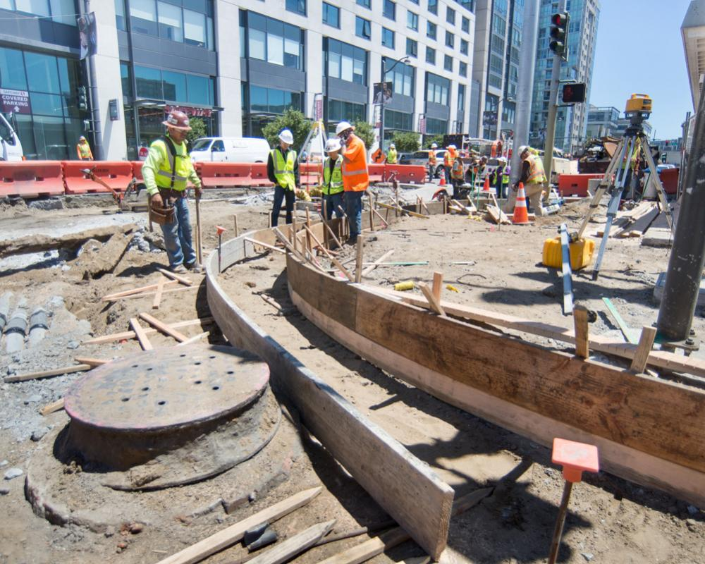 Curved formwork mark the edges of future curbs and gutters during sidewalk restoration work at 4th and Townsend.