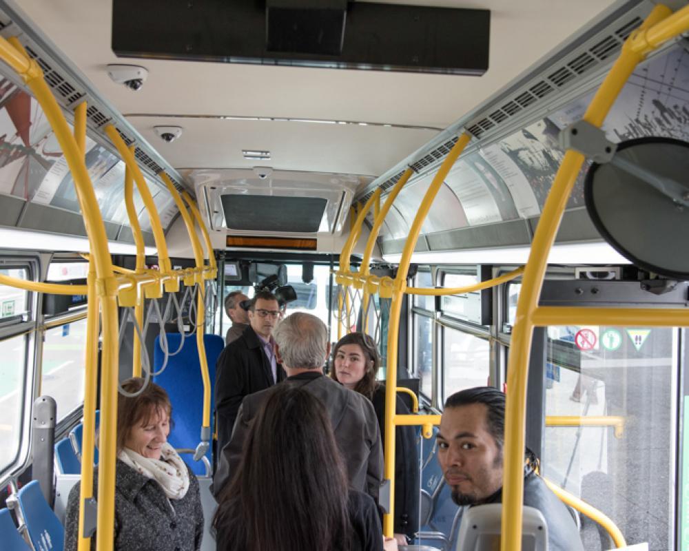 people looking at artwork in bus