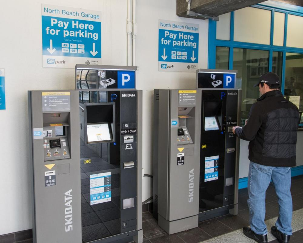 Customer Using New PARCS Payment Equipment at North Beach Parking Garage