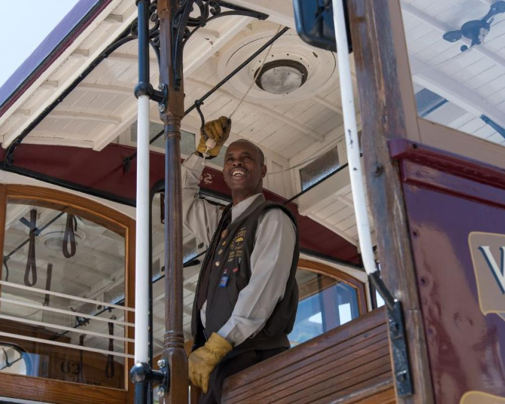A cable car conductor rings the bell as part of the 2017 contest