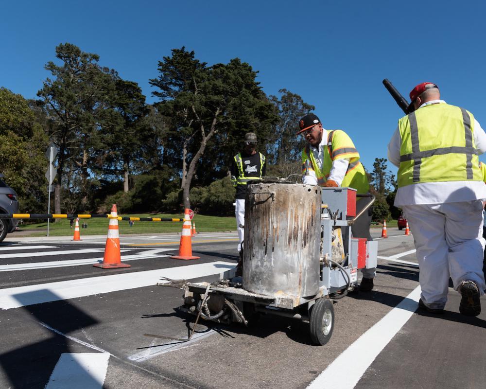 Paint crews working on a crosswalk