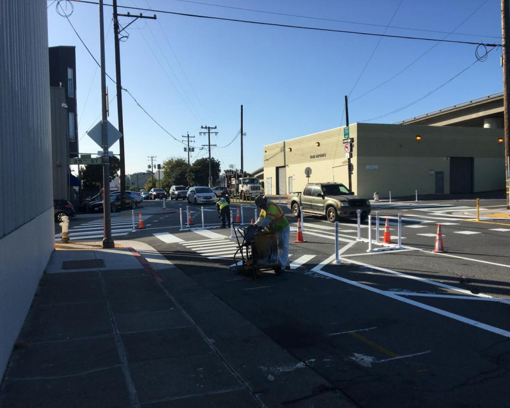 Paint Shop crew members working on striping changes at the intersection of Indiana & 25th