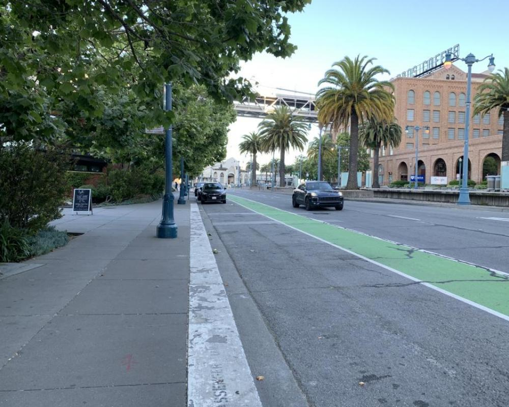 View of the existing passenger loading zone and bike lane in front of the Rincon restaurants, looking south