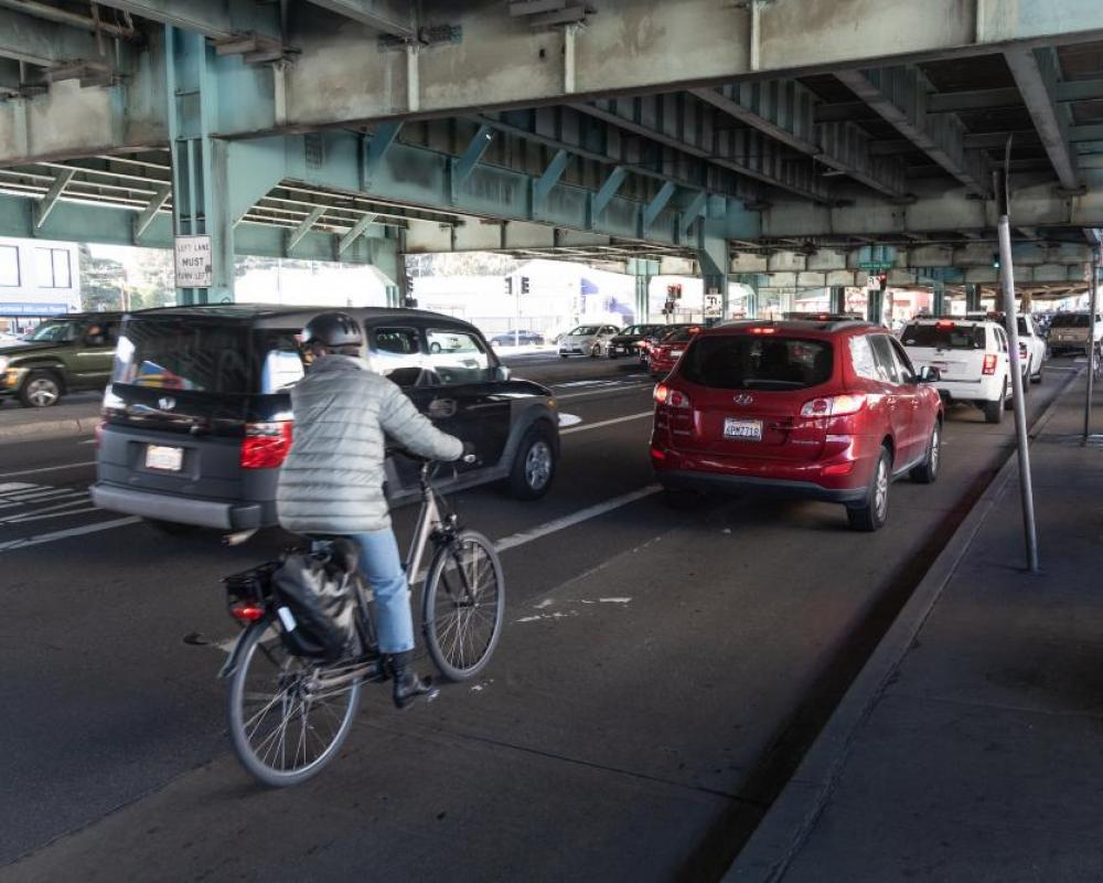 a bicyclist rides in mixed traffic