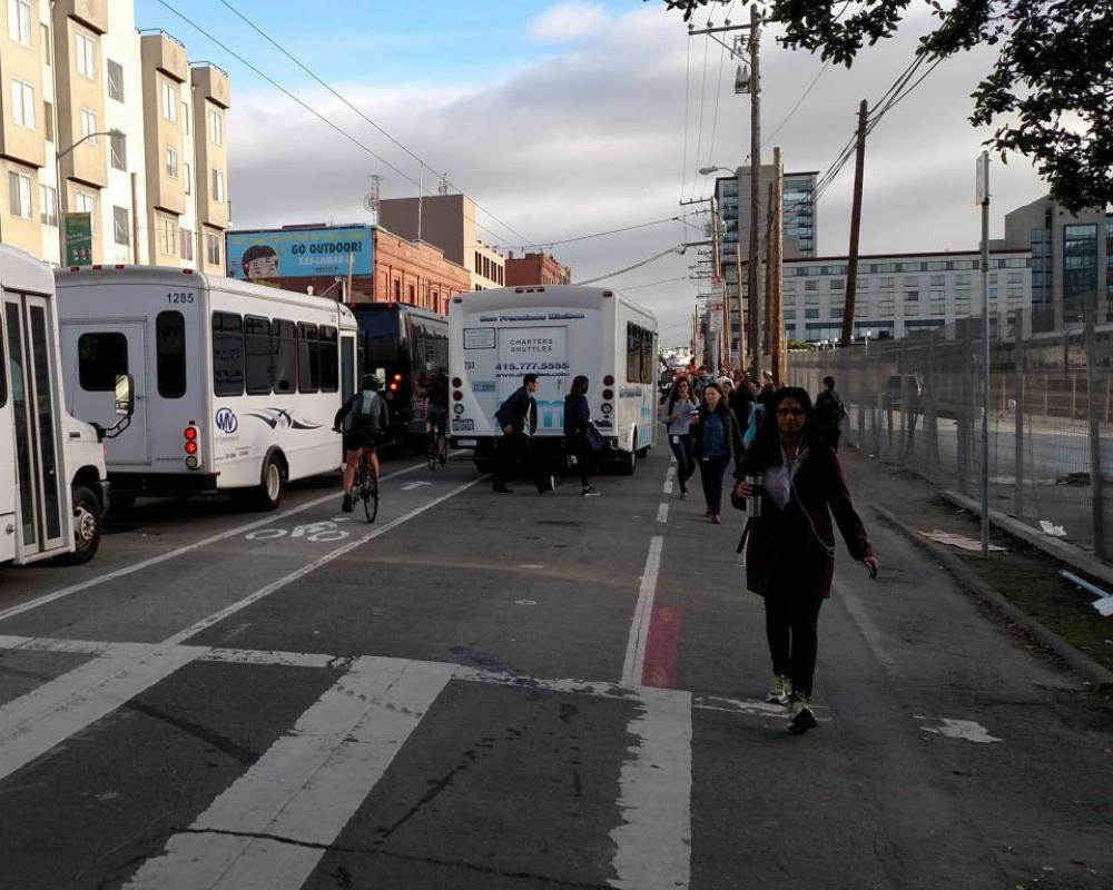 Photo of shuttles blocking and loading in the Townsend bike lane and no sidewalk for pedestrians - November 2016