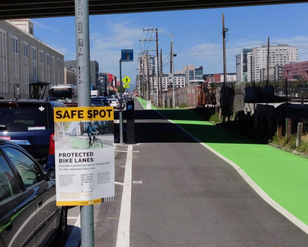 Photo of freshly paved green protected bikeway between 5th and 7th streets - June 2019