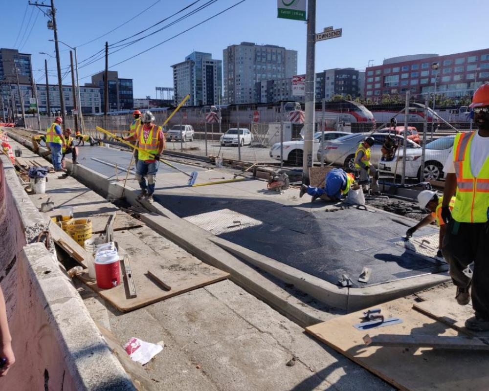 Photo of crews building the sidewalk boarding island at 5th Street - October 2019