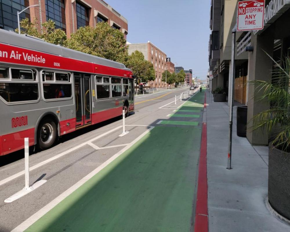 Photo of protected bikeway between 7th and 8th streets with Muni bus driving by - September 2020