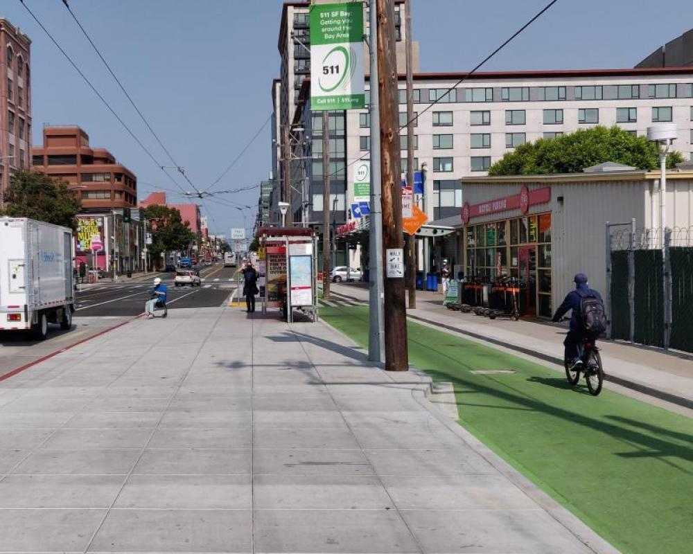 Photo of protected bikeway and bus boarding area near Catrain Station - September 2020