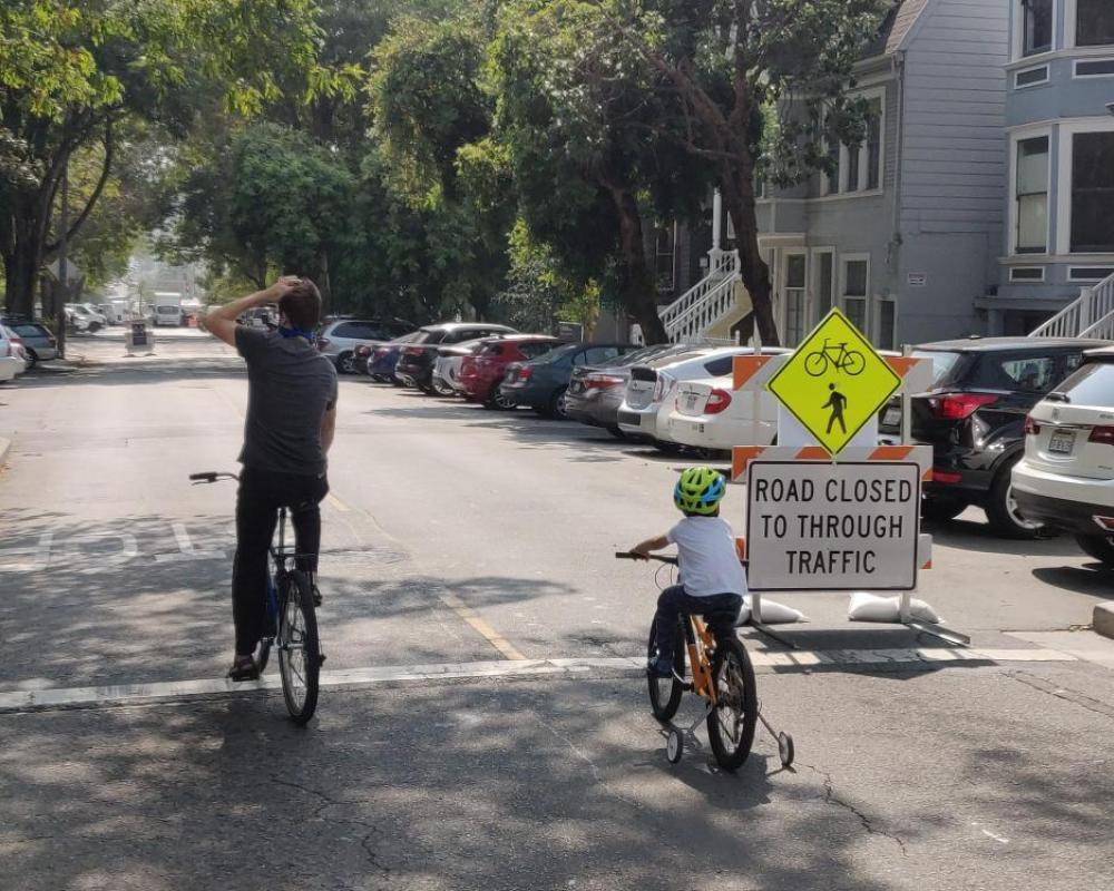 people biking on Noe Street