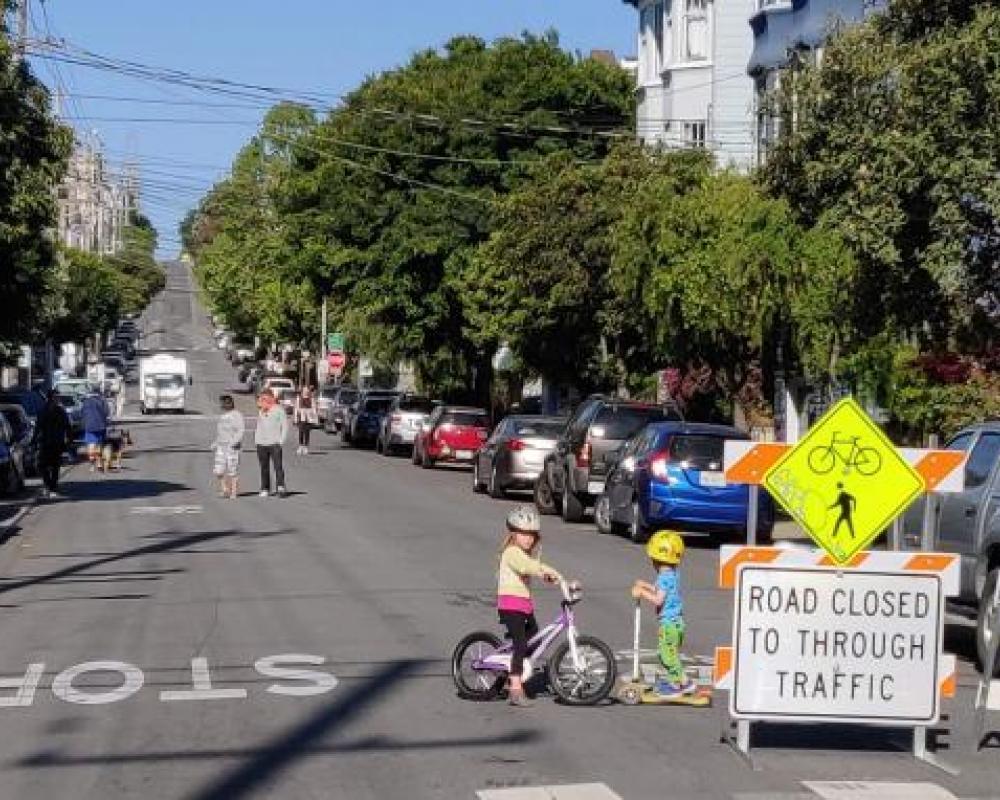 Kids biking on Lake Street