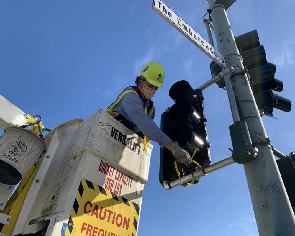 SFMTA crews installing a bike signal