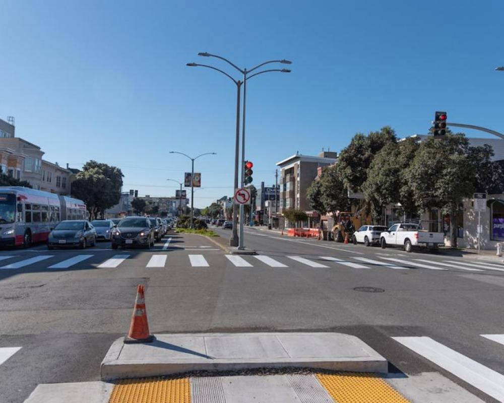 Image of cars stopped at new traffic signal at Cook Street
