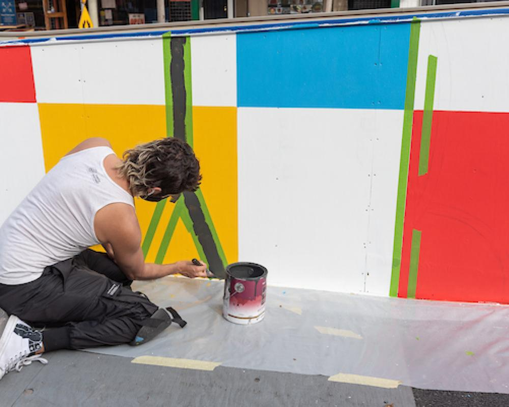 "Simón Malvaez painting his mural ""Them (Ramp)"""